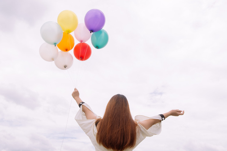 worm-s-eye-view-of-woman-holding-balloons-887824.jpg